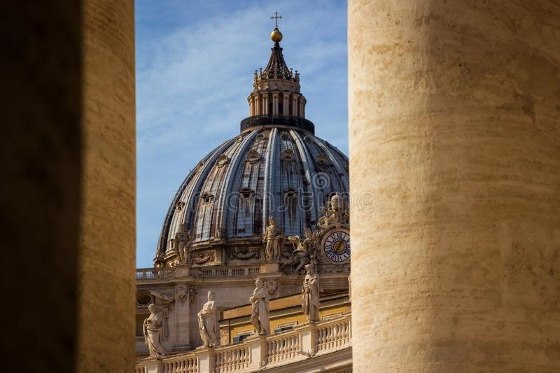 Famous Saint Peter`s dome in Vatican City, Rome, Italy. royalty free stock image
