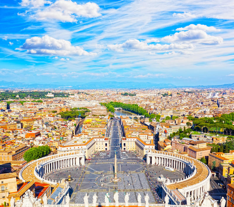 Famous Saint Peter's Square in Vatican and aerial view of the city. Rome, Italy. Famous Saint Peter's Square in Vatican and aerial view of the city royalty free stock photo