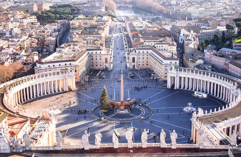 Famous Saint Peter`s Square in Vatican and aerial view of the city Rome, Italy. Located directly in front of St. Peter`s Basilica royalty free stock photos