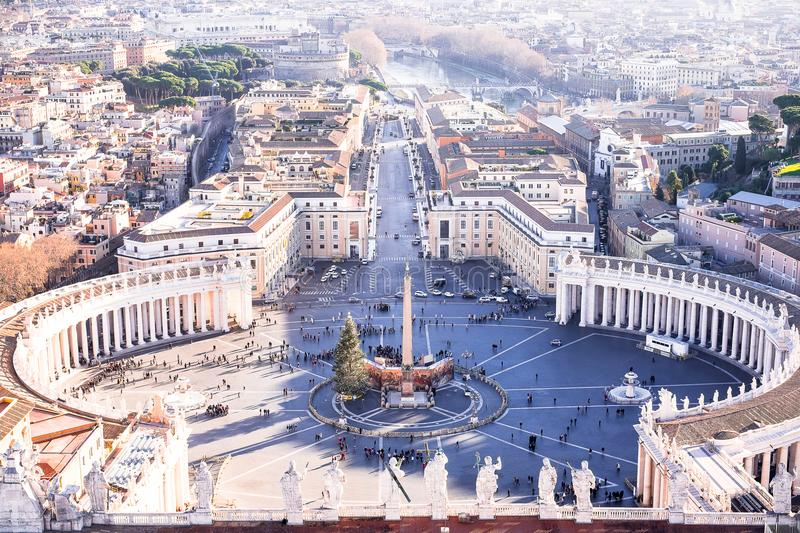Famous Saint Peter`s Square in Vatican and aerial view of the city Rome, Italy. Located directly in front of St. Peter`s Basilica. In the Vatican City, the royalty free stock photos