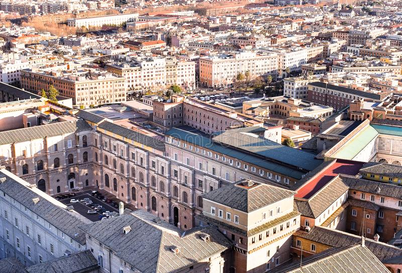 Famous Saint Peter`s Square in Vatican and aerial view of the city Rome, Italy. Located directly in front of St. Peter`s Basilica stock photo