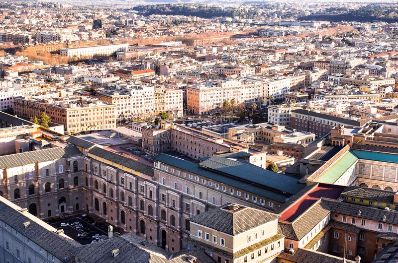 Famous Saint Peter`s Square in Vatican and aerial view of the city Rome, Italy. Located directly in front of St. Peter`s Basilica stock images
