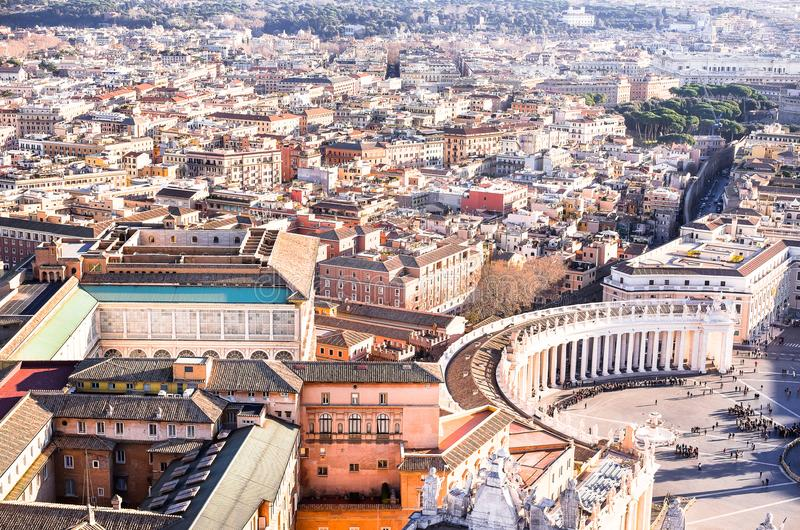 Famous Saint Peter`s Square in Vatican and aerial view of the city Rome, Italy. Located directly in front of St. Peter`s Basilica royalty free stock image