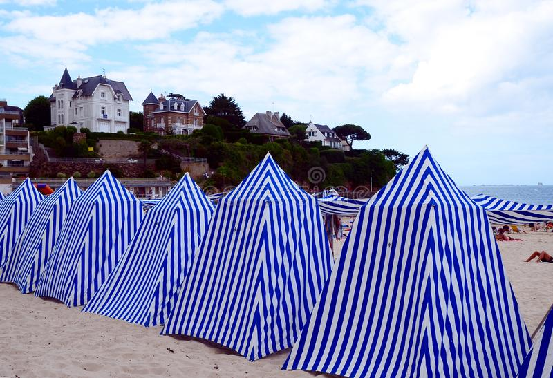Famous sandy beach in Dinard with its stripy beach tents. The most British of Brittany's resorts is popular with families who are attracted by its sandy stock image