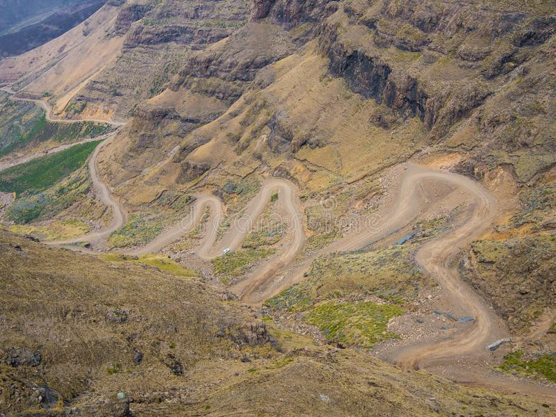 The famous Sani mountain pass dirt road with many tight curves connecting Lesotho and South Africa stock photography