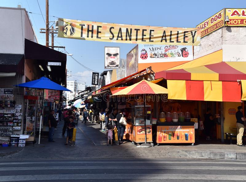 The Famous Santee Alley. LOS ANGELES, CA/USA - JUNE 19, 2017: Shoppers and vendors fill the famous Santee Alley in the Los Angeles Fashion District stock photo