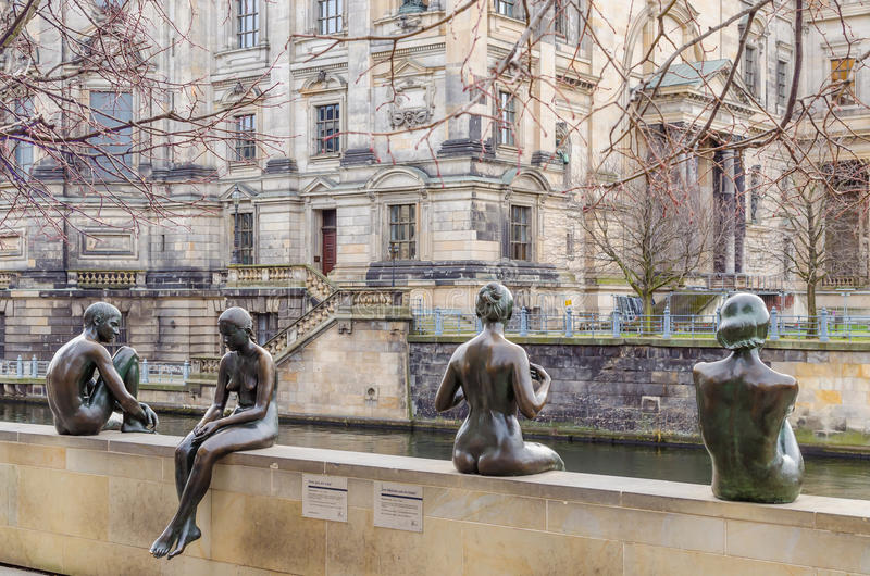 Famous sculpture Bathers on the Spree in Berlin. Its located on Spreepromenade near Berliner Dom and Radisson Blu Hotel, Berlin, Germany. Sculptural royalty free stock image