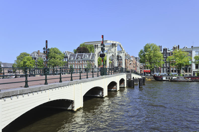 Famous 'Skinny Bridge' in Amsterdam canal belt. stock photos