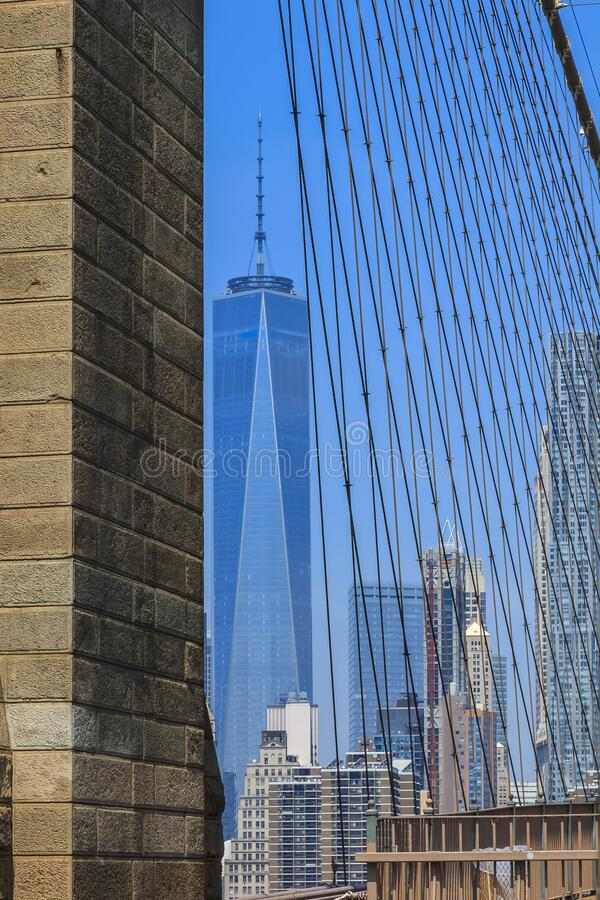 Skyline of downtown New York and Lower Manhattan in New York City, USA seen through the cables of the Brooklyn Bridge royalty free stock images