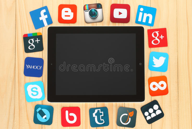 Famous social media icons placed around iPad stock illustration