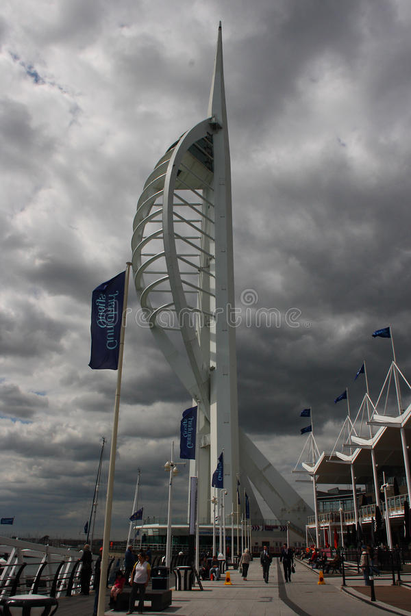 The famous Spinnaker Tower in the port of Portsmouth on the South coast of England with local business returning to their offices. As tourists catch the last of stock photography