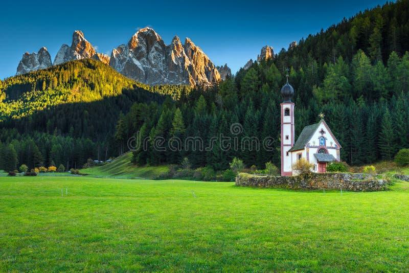 Famous St Johann church in Santa Maddalena alpine village, Italy. Traditional alpine St Johann church in Val di Funes valley, Santa Maddalena touristic village stock photos