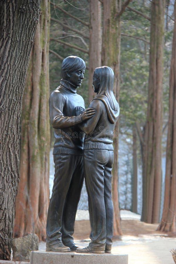 Famous Statue of Bae Yong-Joon and Choi Ji-Woo from Korean Television Drama Series Winter Sonata on Nami Island, South Korea royalty free stock images