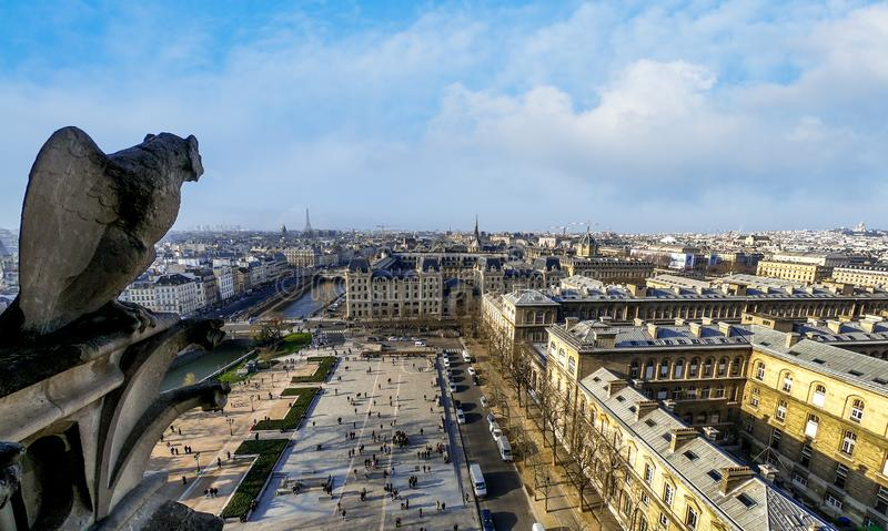 Famous Stone Gargoyle Statue In Notre Dame Cathedral With City Of Paris royalty free stock photography