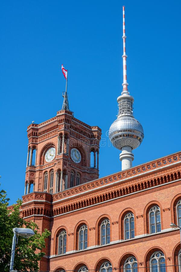 The famous Television Tower and the tower of the city hall in Berlin royalty free stock photography