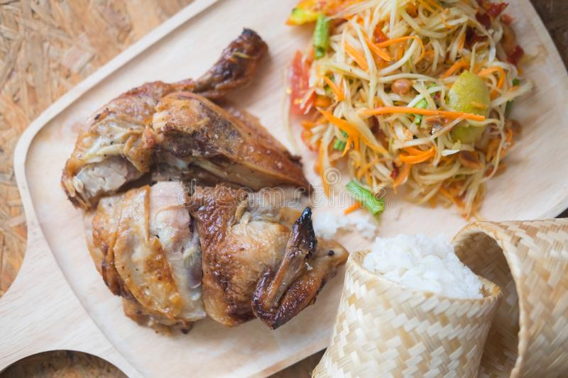 Papaya salad and grilled chicken with sticky rice royalty free stock image