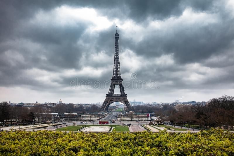 Tour Eiffel at the end of winter under storm clouds stock images