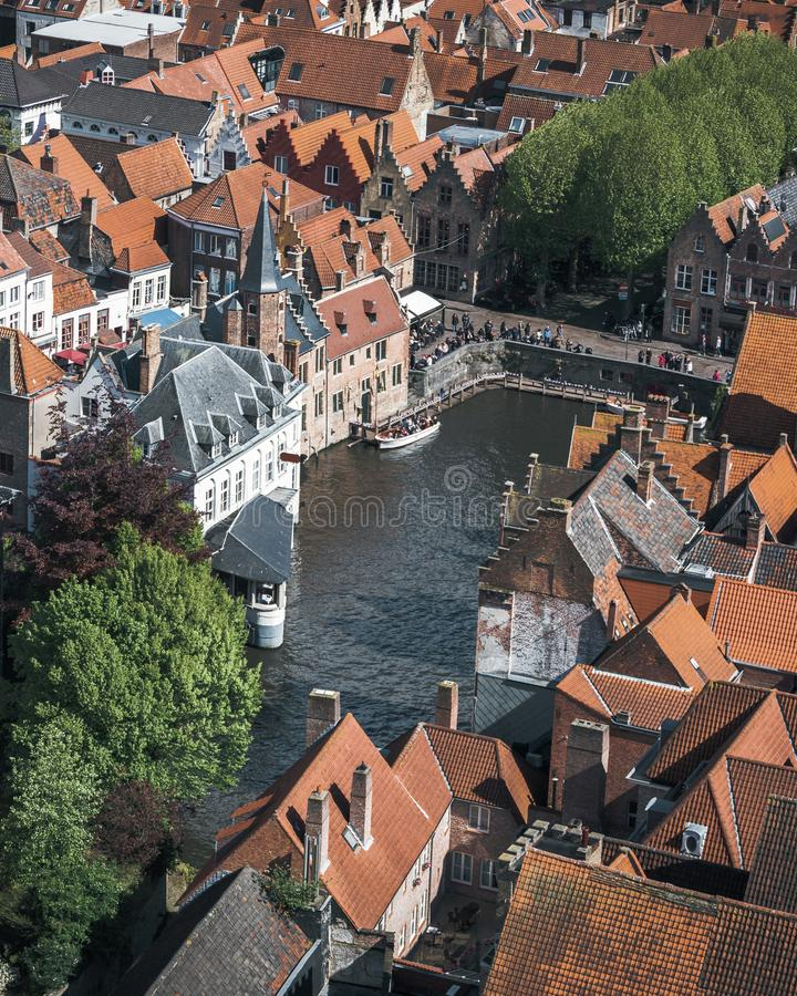 Famous tourist destination for photos in Bruges, Belgium. Aerial view, view from the Belfort tower. Corner of the street where all the tourists take a typical stock photography