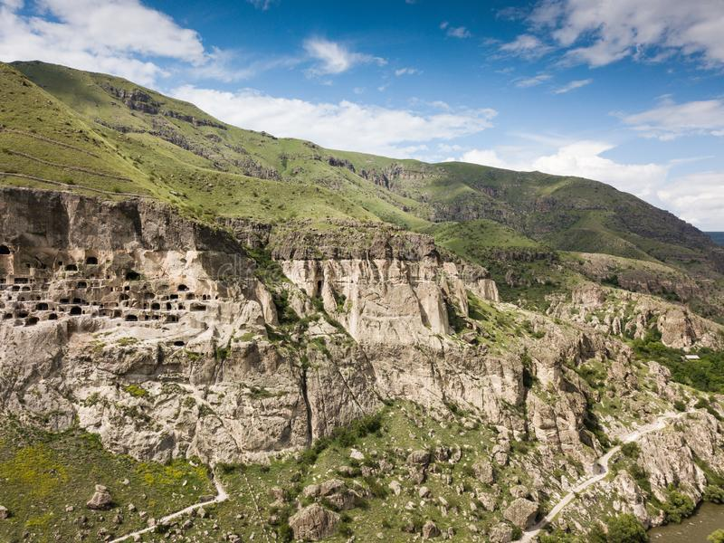 Aerial view to Vardzia cave monastery excavated from Erusheti Mountain on the left bank of the Mtkvari River, near Aspindza. Famous touristic place to Vardzia royalty free stock photography