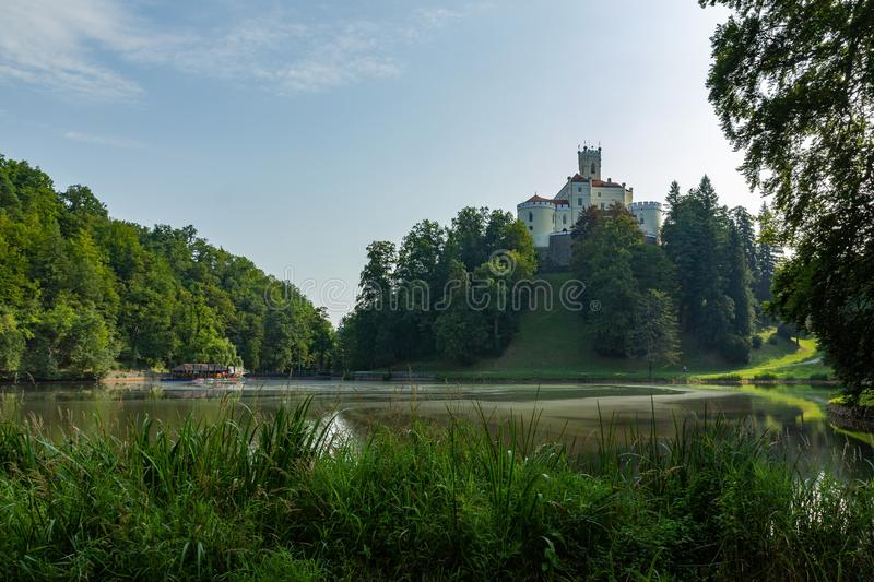 Famous Trakoscan Castle in Croatia surrounded by a forest and a lake stock photos