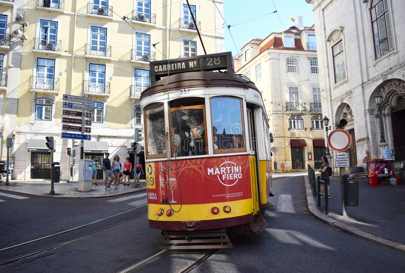 Tram 28 in Lisbon`s Baixa District. The famous tram number 28 in Lisbon Portugal heading from the downtown Baixa district to Alfama the old city stock images