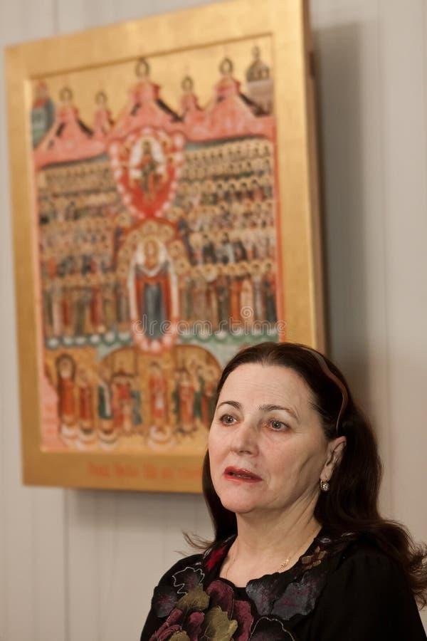 Nina Matvienko, famous Ukrainian folk singer, being interviewed at art exhibition opening in folk art museum, Kyiv, 01.03.2013 royalty free stock photography