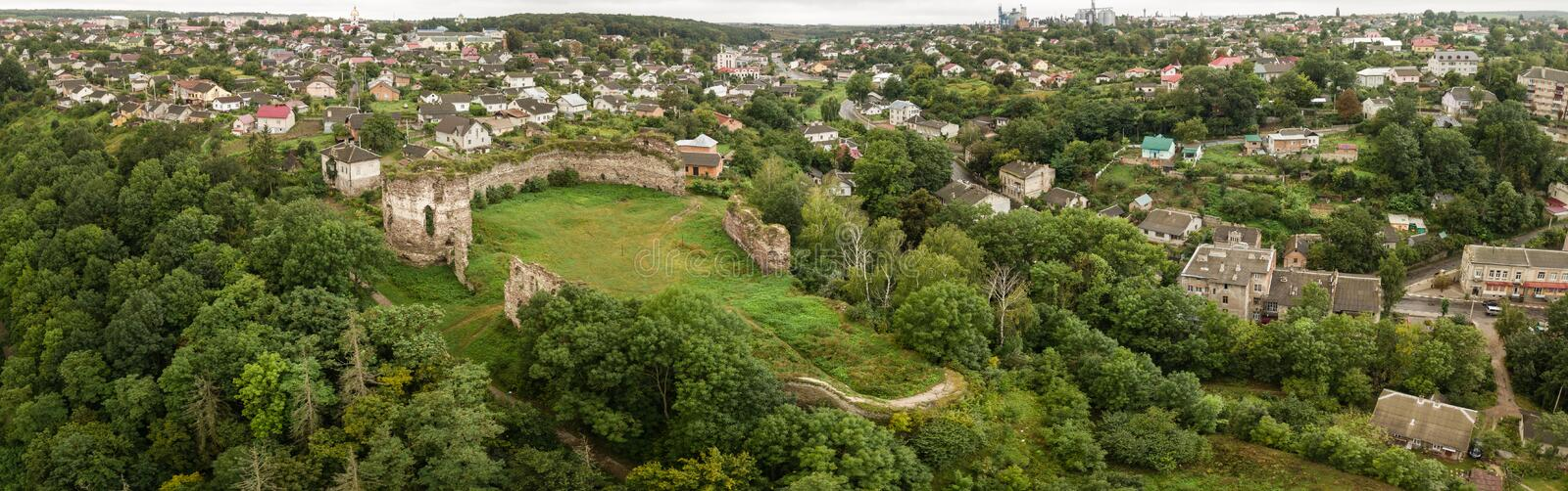 Aerial top view from drone to castle ruins in Buchach, Ternopil region, Ukraine. Famous ukranian sights - panoramic view from drone to castle ruins and city royalty free stock photography