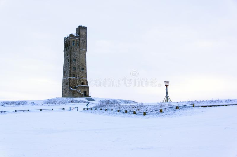 Victora Tower on Castle Hill in Huddersfield, West Yorkshire, England. The Famous Victoria Tower built to commemorate Queen Victoria on Castle Hill a once iron royalty free stock photography