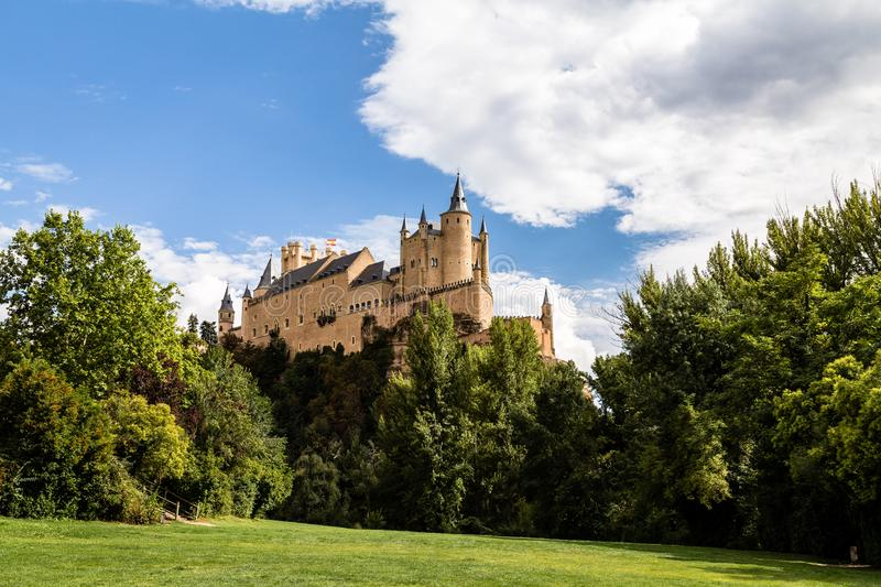 The famous view of the Alcazar of Segovia in a sunny summer day from the view point of la Pradera de San Marcos, Segovia, Spain stock photos
