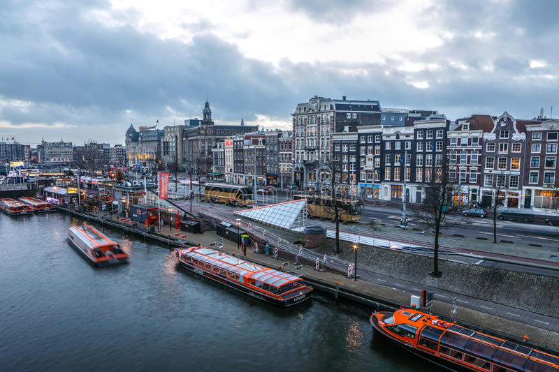Famous vintage buildings & chanels of Amsterdam city at sun set. General landscape view. AMSTERDAM, NETHERLANDS - JANUARY 10, 2017: Famous vintage buildings & royalty free stock photography