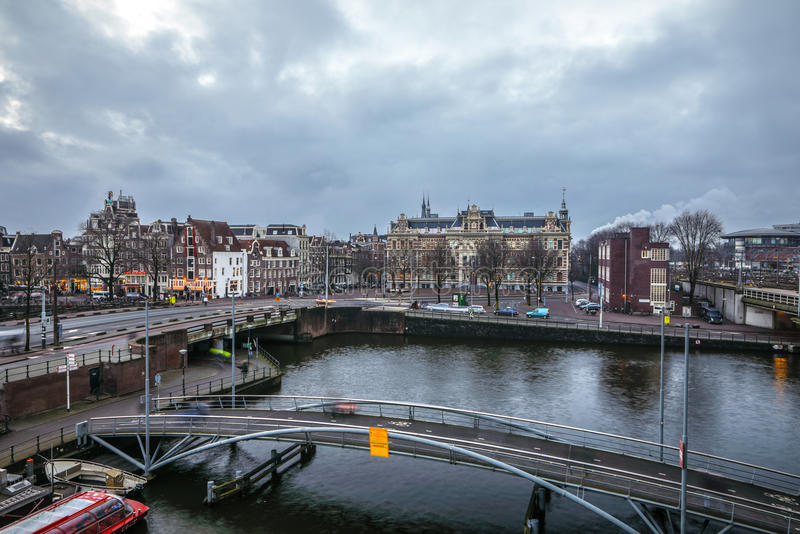Famous vintage buildings & chanels of Amsterdam city at sun set. General landscape view. AMSTERDAM, NETHERLANDS - JANUARY 10, 2017: Famous vintage buildings & royalty free stock photo