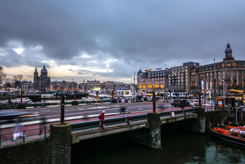 Famous vintage buildings & chanels of Amsterdam city at sun set. General landscape view. AMSTERDAM, NETHERLANDS - JANUARY 10, 2017: Famous vintage buildings & royalty free stock photos