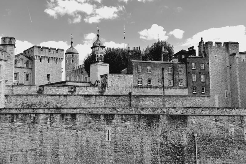 The famous White Tower and the Tower of London from South Bank across the River Thames. Popular historical tourist attraction on a stock photography