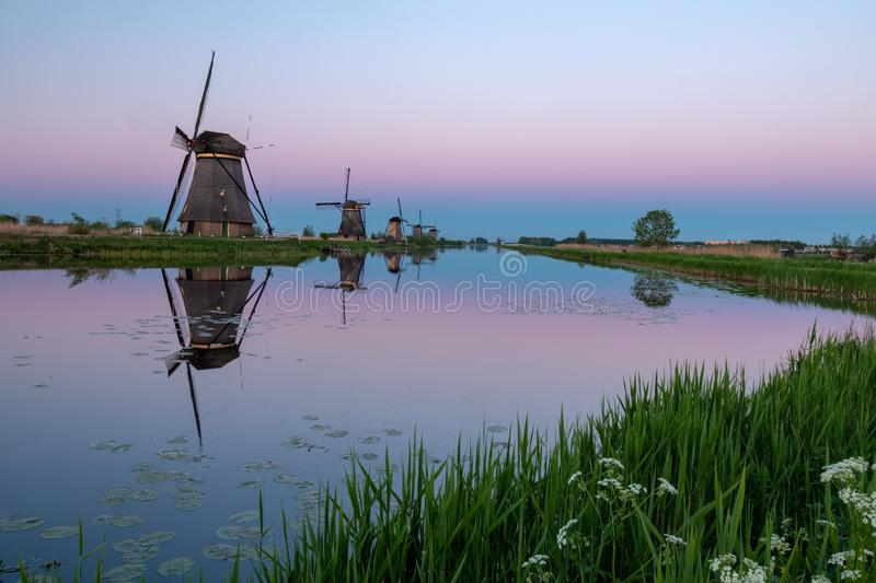 Windmills of Kinderdijk, the Netherlands. The famous windmills 19 in total of Kinderdijk are part of a UNESCO World heritage site. Located near Rotterdam, it is stock photos