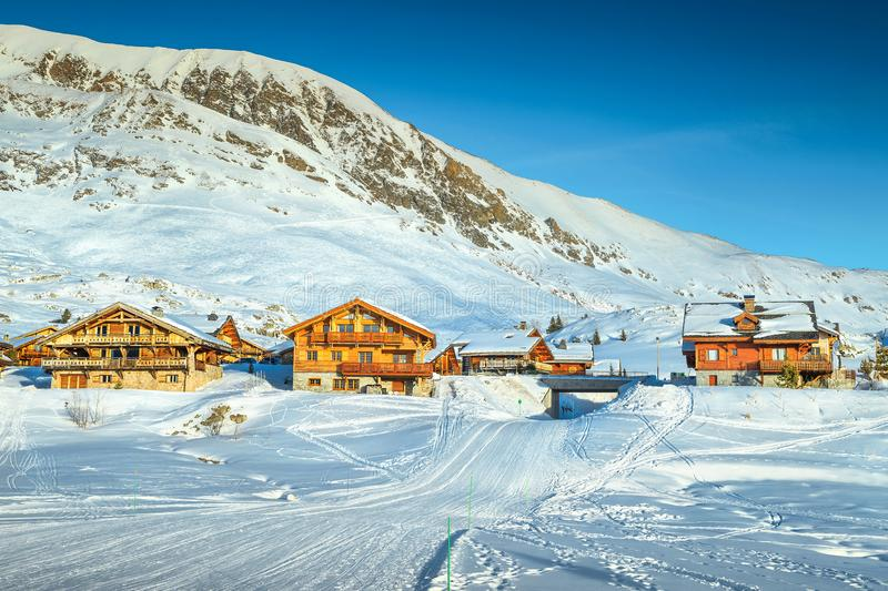 Famous winter ski resort in the French Alps, Europe. Wonderful winter landscape with wooden chalets and ski slopes in French Alps, Alpe D Huez, France, Europe stock photos