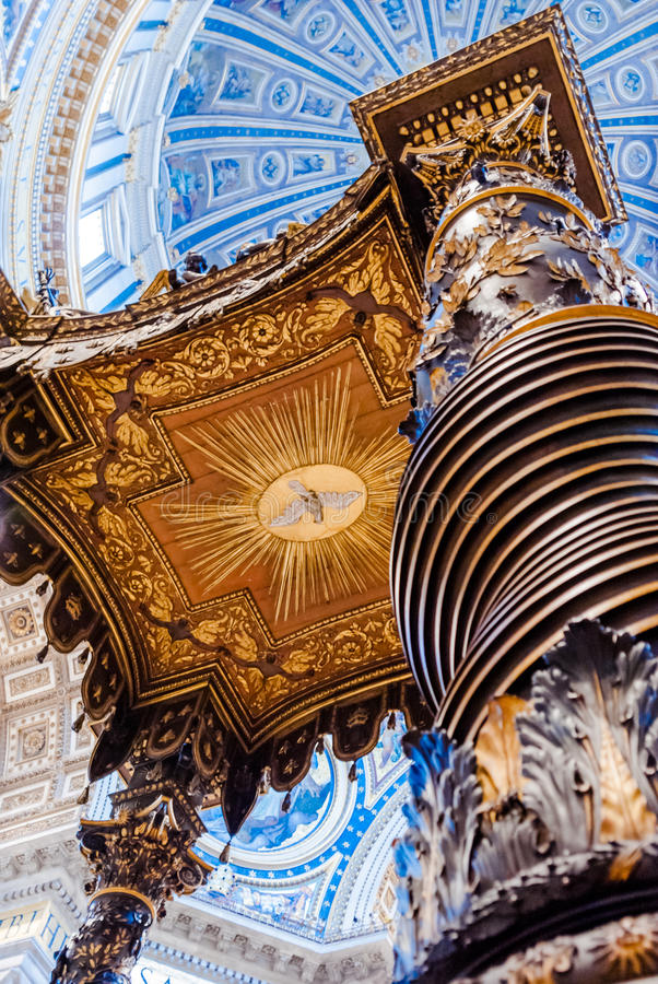 The famous wooden baldachin, altar of Saint Peter basilica was m. Rome, Italy - MARCH 05, 2013: Closeup of Bernini`s Baldacchino under the dome of St. Peter`s royalty free stock image