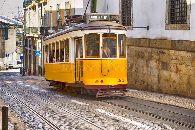 Famouse Yellow Tram in the Oldest Part of Lisbon - Alfama, Portugal stock photo