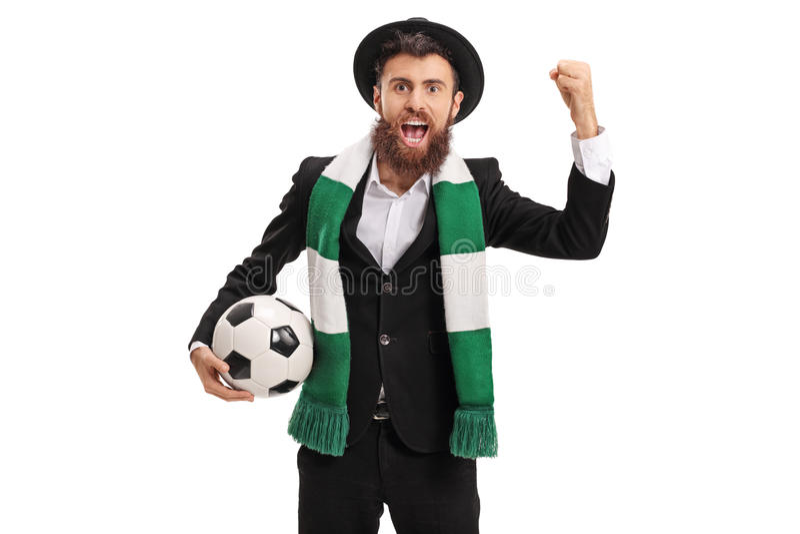 Fanático del fútbol eufórico con animar de la bufanda fotografía de archivo