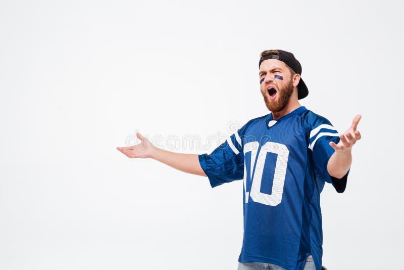 Fan émotive criarde d'homme dans le T-shirt bleu photo stock
