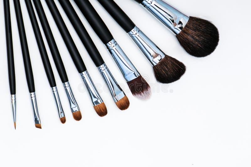 Fan av makeupborstar arkivbild