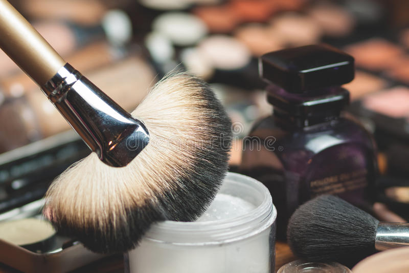 Fan brush. Powder application. Professional visagiste workspace. Makeup tools royalty free stock photos