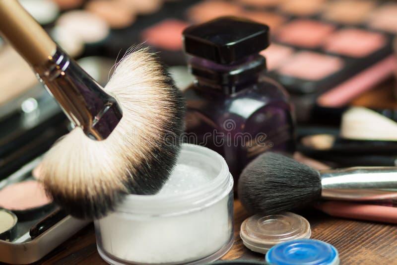 Fan brush. Powder application. Professional visagiste workspace. Makeup tools royalty free stock photography