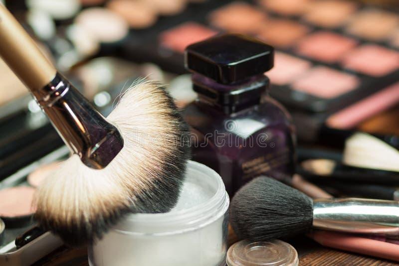 Fan brush. Powder application. Professional visagiste workspace. Makeup tools stock photos