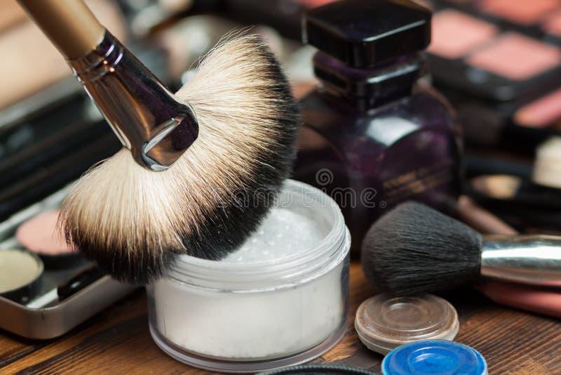 Fan brush. Powder application. Professional visagiste workspace. Makeup tools stock photo