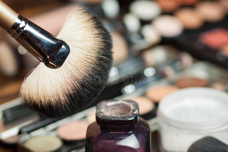 Fan brush. Professional visagiste workspace. Makeup tools. Powder application stock photography