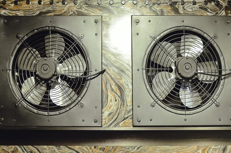 The fan is built into the wall. Modern kitchen hood stock photo