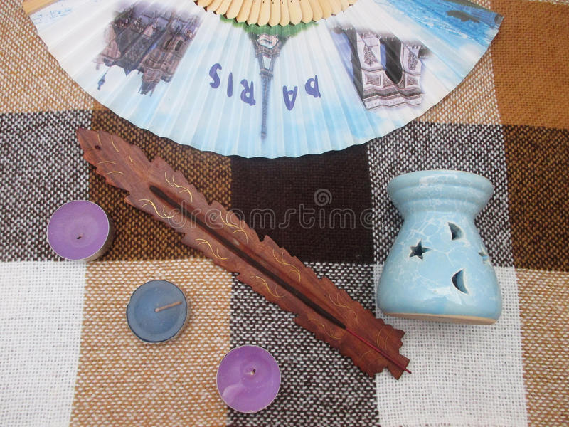 Fan, candles, an oil burner, the sticks royalty free stock photos