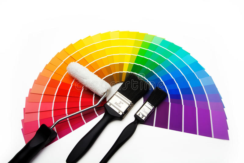 A fan of colour swatch samples. Colour swatches, paintbrushes and roller stock photos