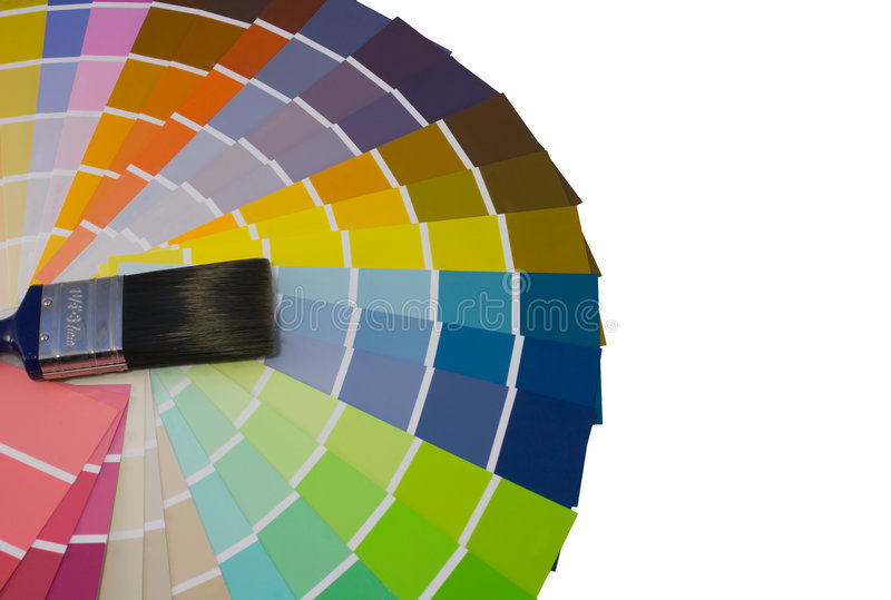 Fan of colour swatches and paint brush. On a white background royalty free stock photos