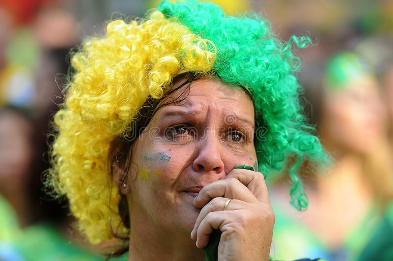 Fan crying. Rio de Janeiro, Brazil, July 8, 2014.nFan crying in the defeat of the Brazilian team in the game Brazil vs Germany for the World Cup 2014, in Alzira stock image